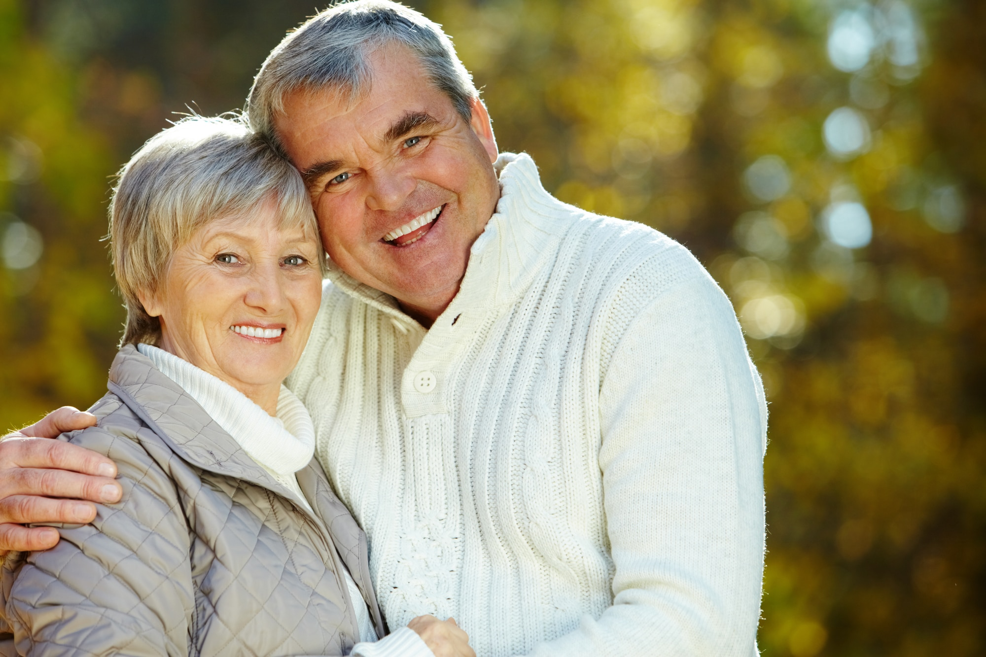 Photo of amorous aged man and woman looking at camera